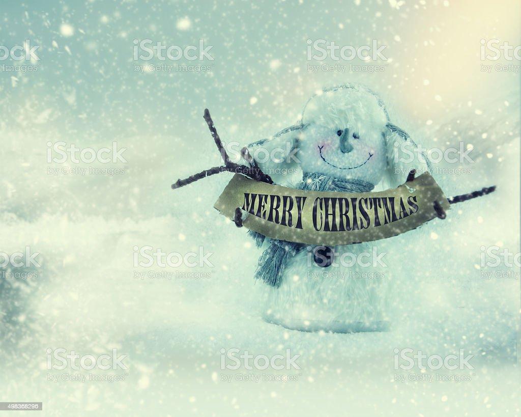 Happy snowman on winter background. stock photo
