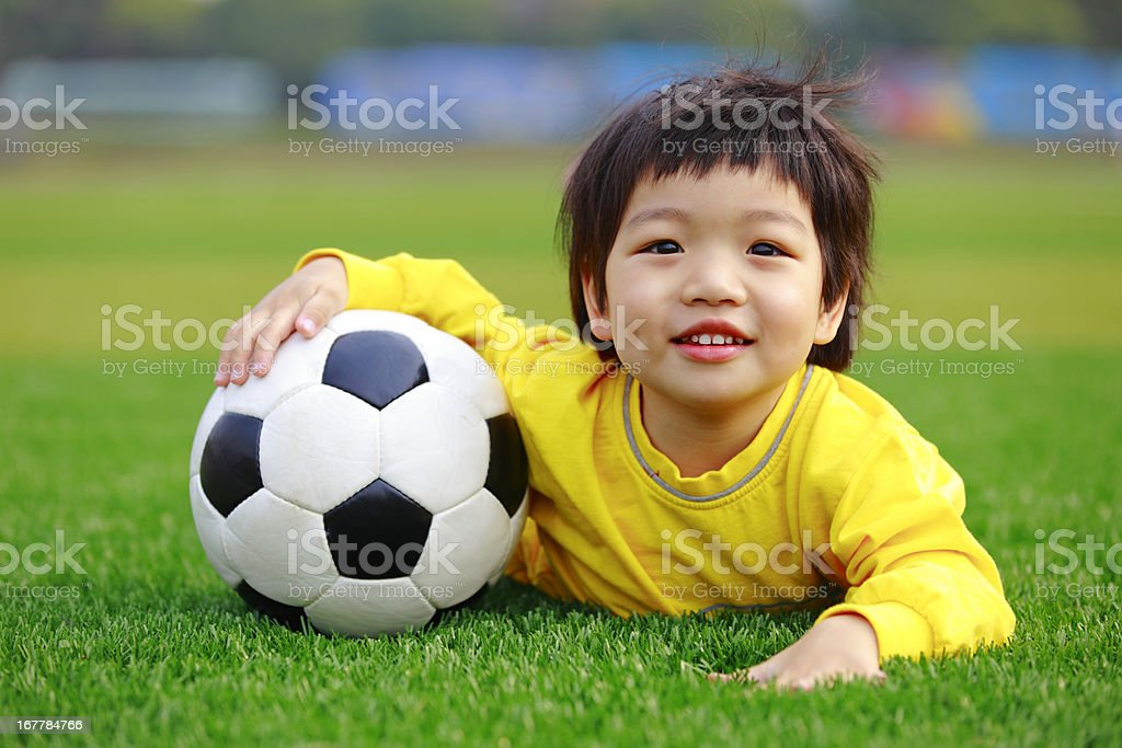 Happy Soccer Girl Lying On Lawn royalty-free stock photo
