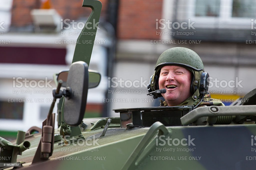 Happy soldier in armored vehicle stock photo