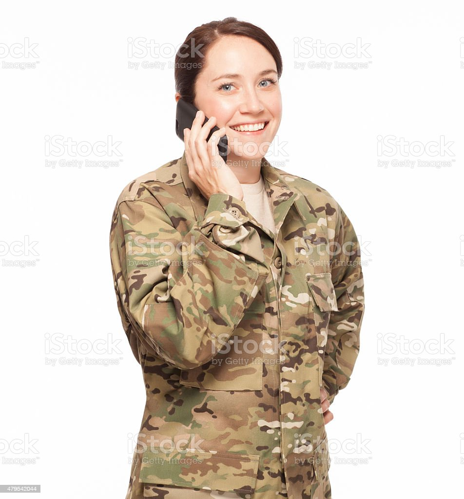 Happy soldier on cell phone. stock photo