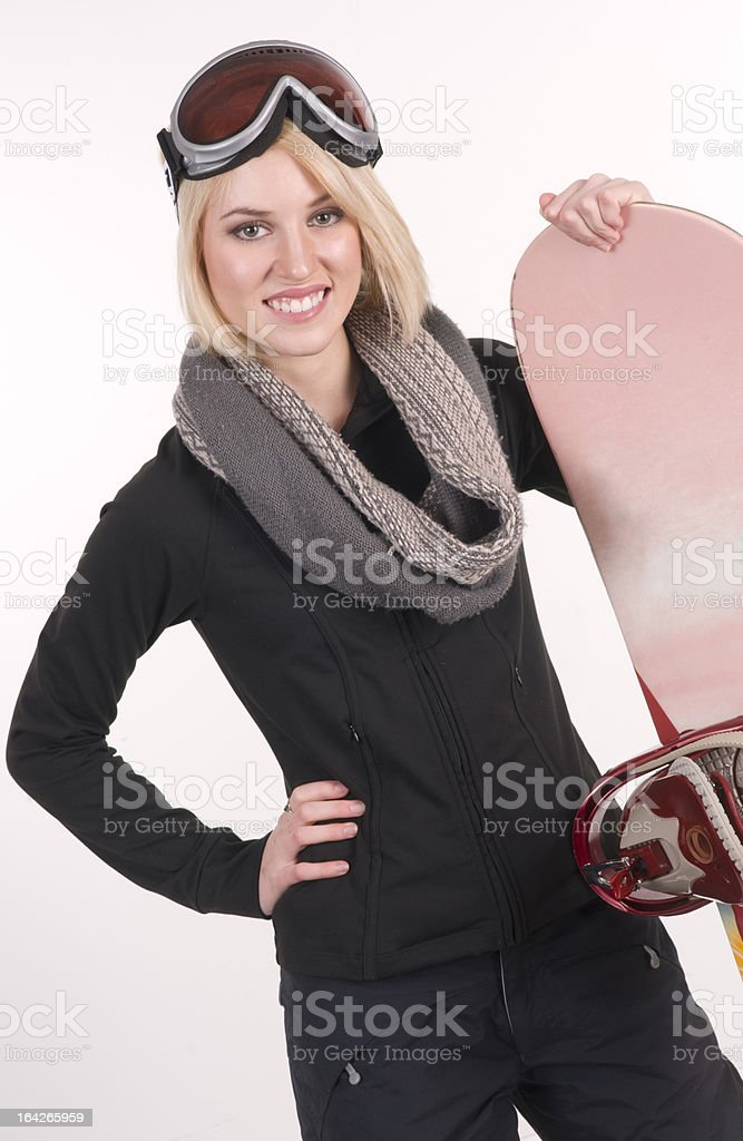 Happy Sports Woman Stands in Full Gear with her Snowboard royalty-free stock photo