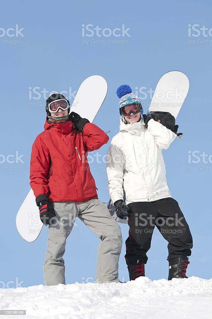 Happy sportsman with snowboards royalty-free stock photo
