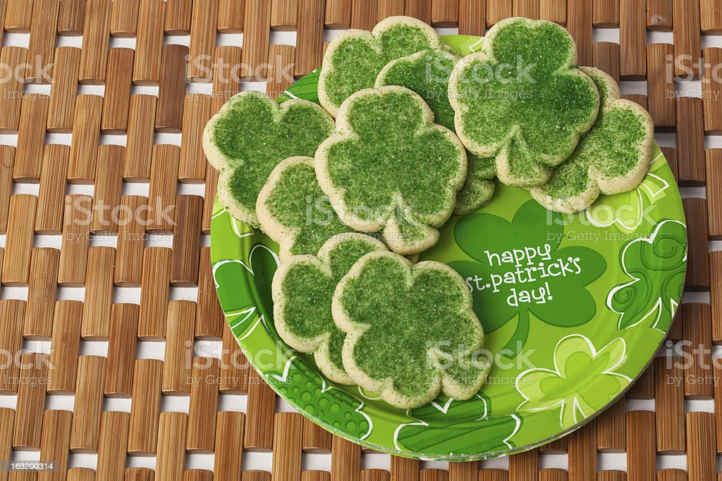 Happy St. Patrick's Day Cookies on a Brown Mat stock photo