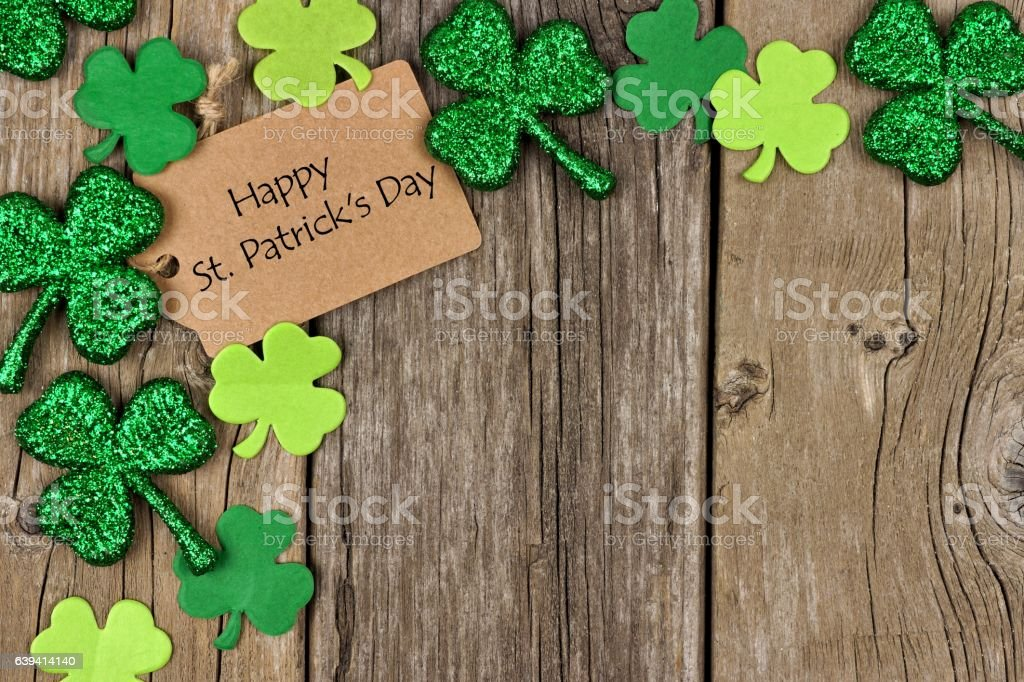Happy St Patricks Day tag with shamrock corner border stock photo