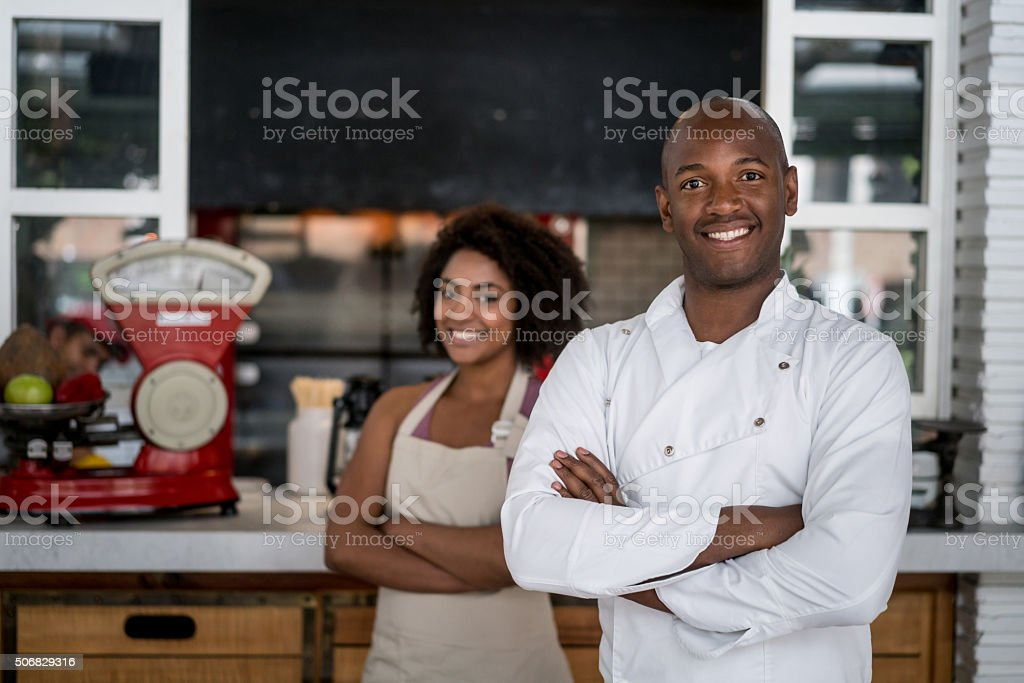 Happy staff at a restaurant stock photo