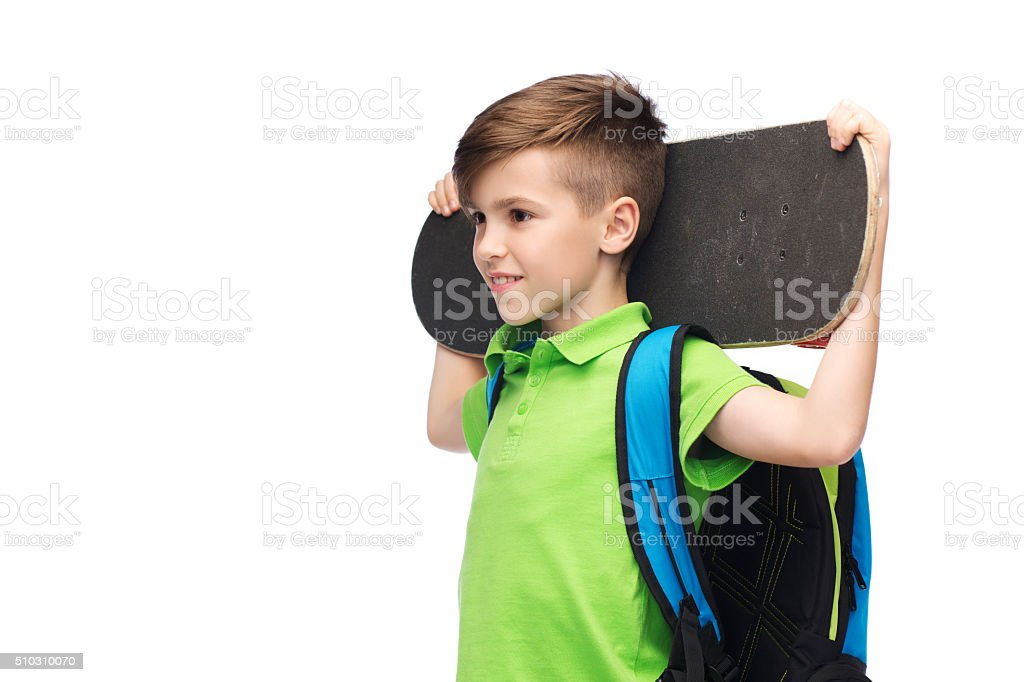 happy student boy with backpack and skateboard stock photo