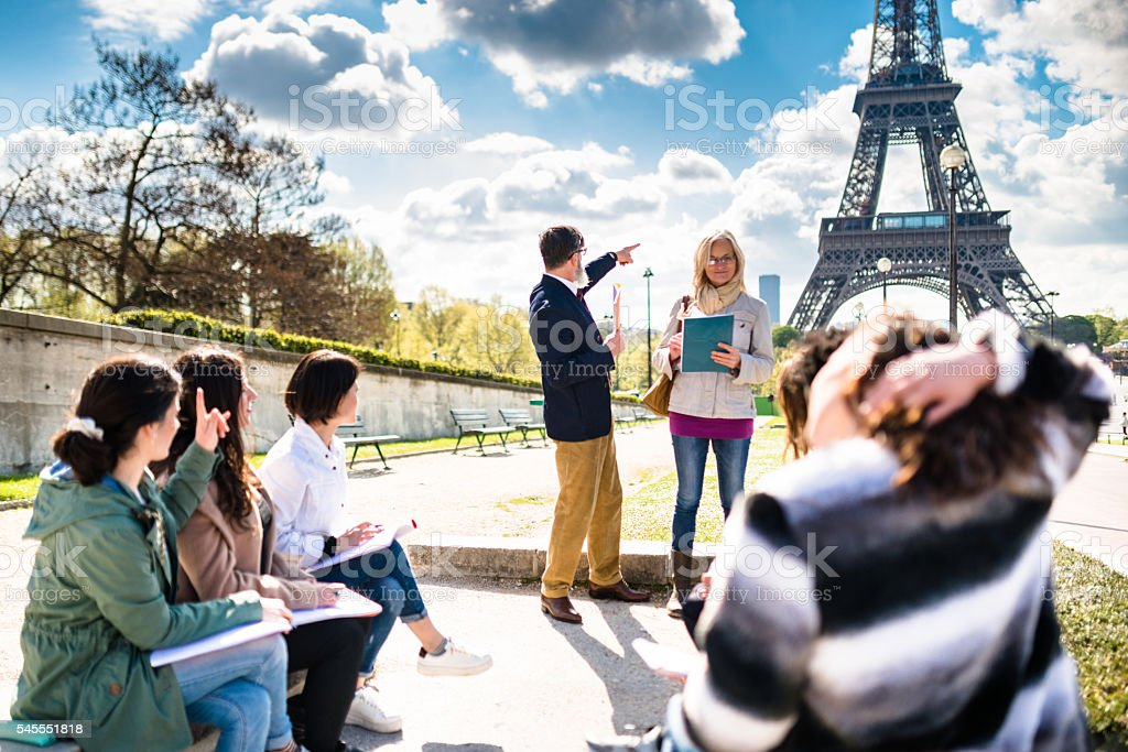 Happy student in paris during the lesson stock photo