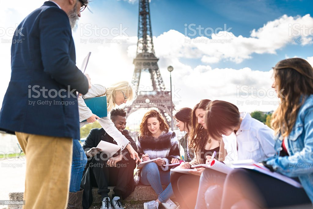 Happy student in paris stock photo