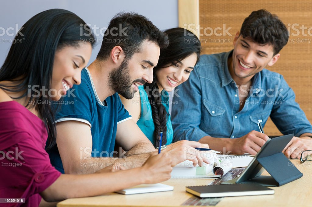 Happy student studying together stock photo