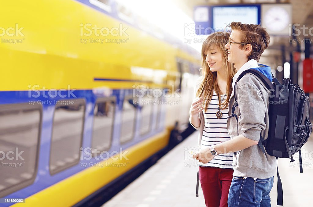 happy students going to travel by train stock photo