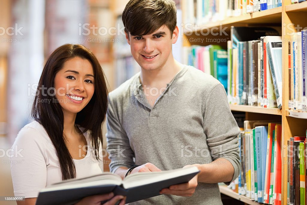 Happy students holding a book royalty-free stock photo