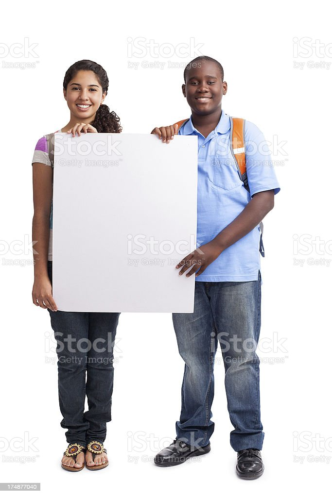 Happy students holding a sign royalty-free stock photo