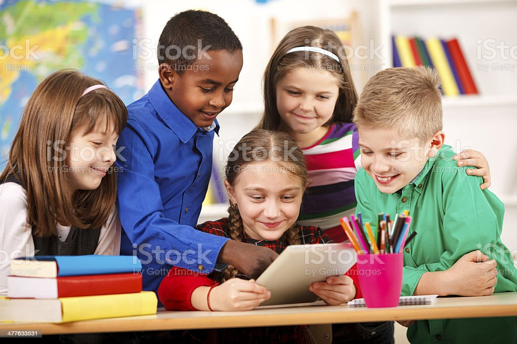 Happy Students In Classroom Using Digital Tablet stock photo
