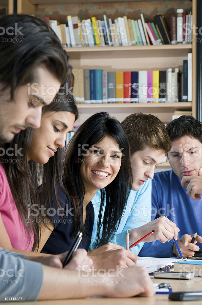 Happy students in college library royalty-free stock photo