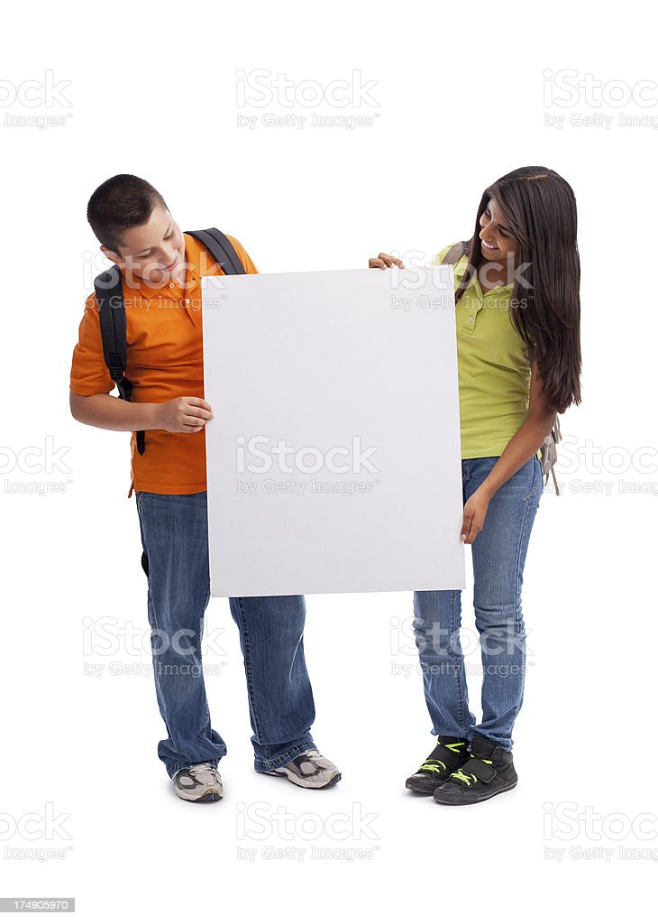Happy students looking at the sign royalty-free stock photo