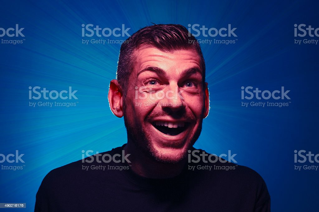Happy, stupefied, surprised man with open mouth expression stock photo