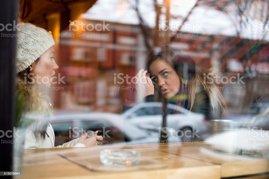 Happy stylish friends having coffee together stock photo