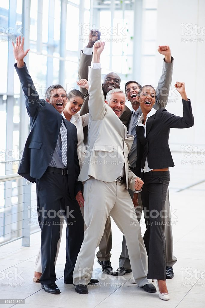 Happy successful business colleagues raising hands royalty-free stock photo
