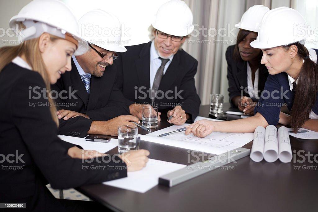Happy successful engineers brainstorming royalty-free stock photo