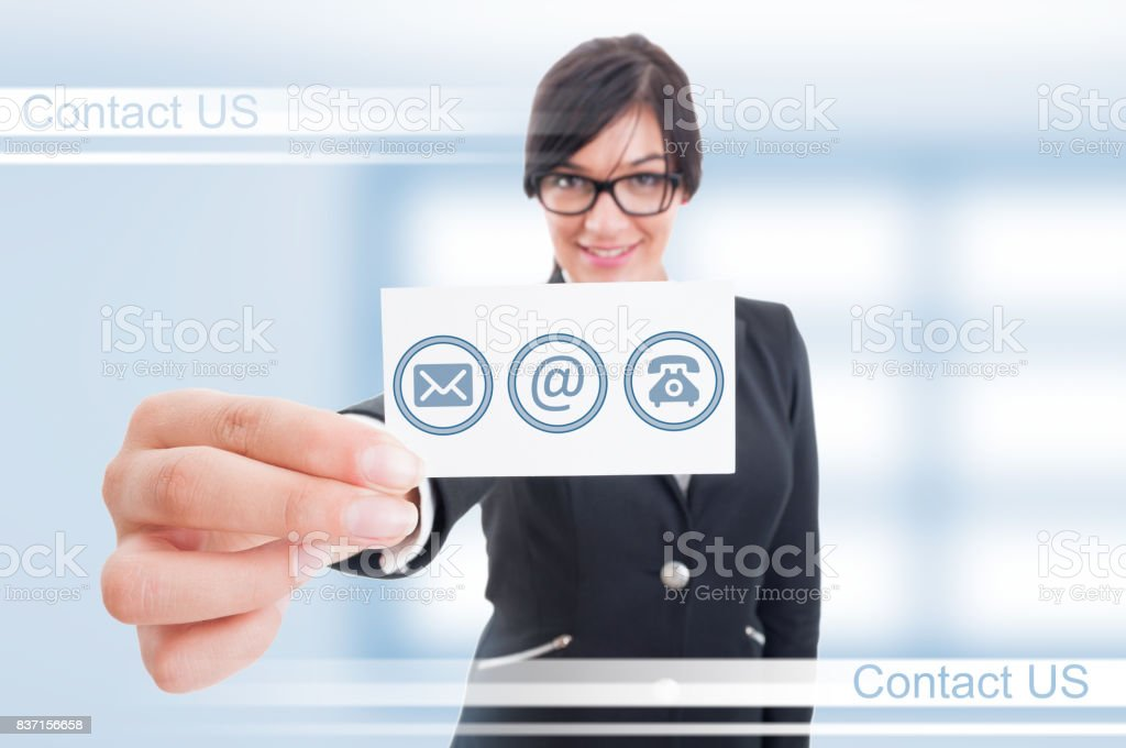 Happy successful female showing her business card stock photo