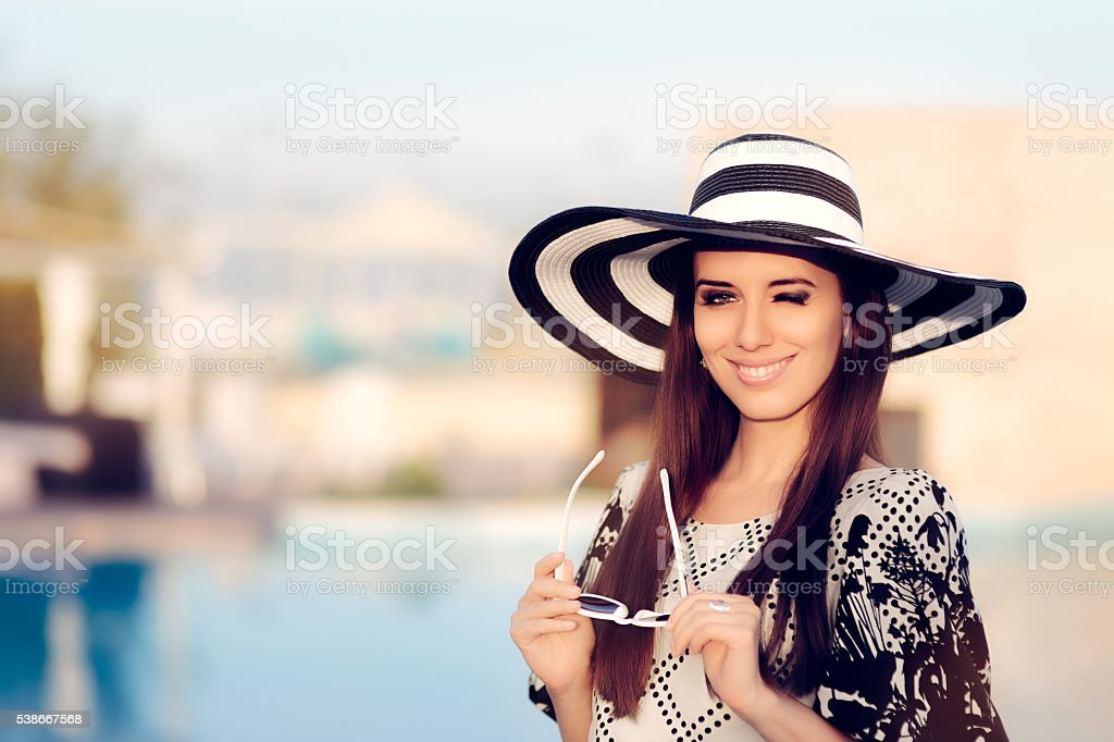 Happy Summer Woman With Sunglasses by the Pool stock photo