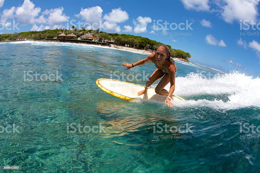 Happy surfer girl stock photo