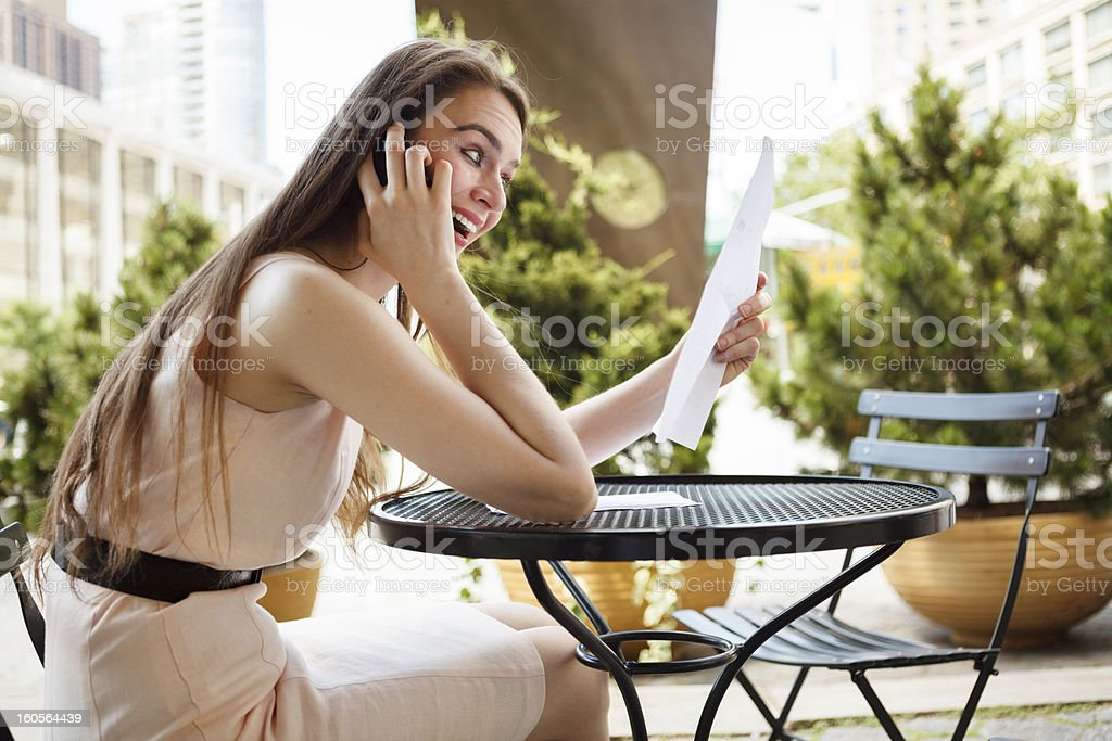 Happy Surprised Woman at Table royalty-free stock photo
