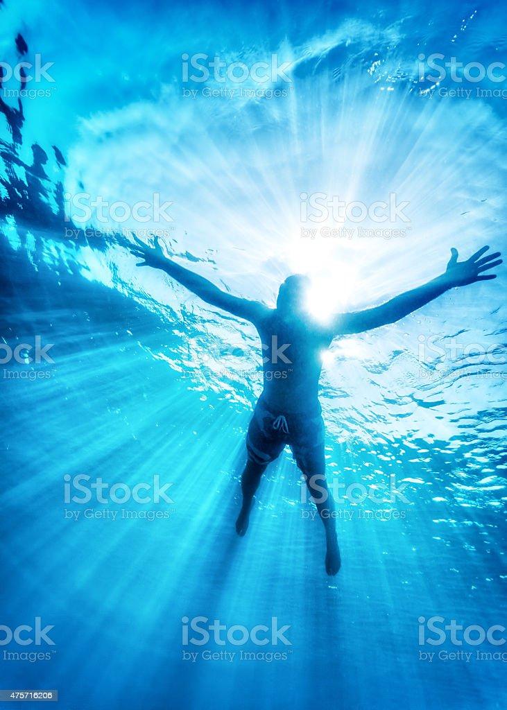 Happy swimming in the sea stock photo