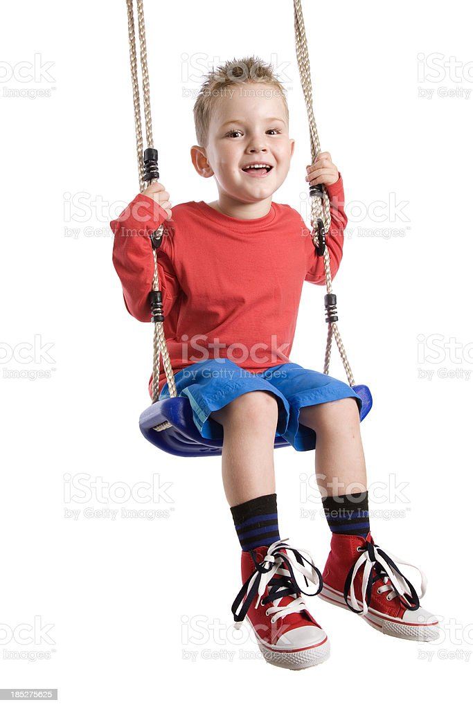 Happy Swinging Boy royalty-free stock photo