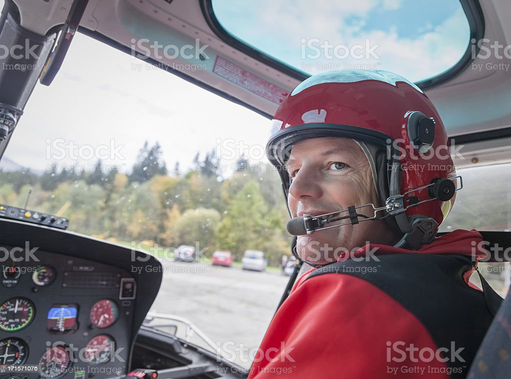 Happy Swiss Male Pilot Flying Helicopter stock photo