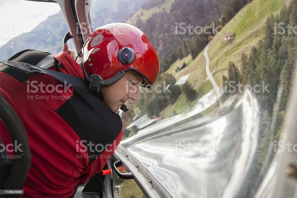 Happy Swiss Male Pilot Flying Helicopter royalty-free stock photo
