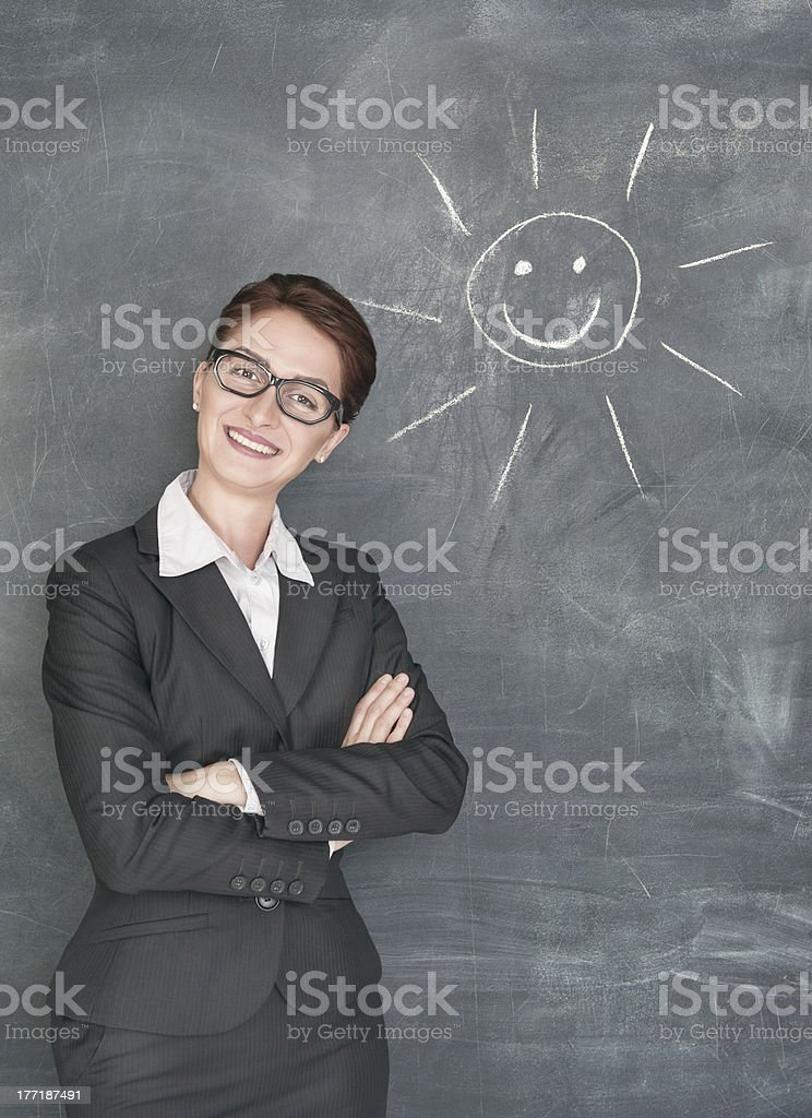Happy teacher and smiling sun on the chalkboard royalty-free stock photo