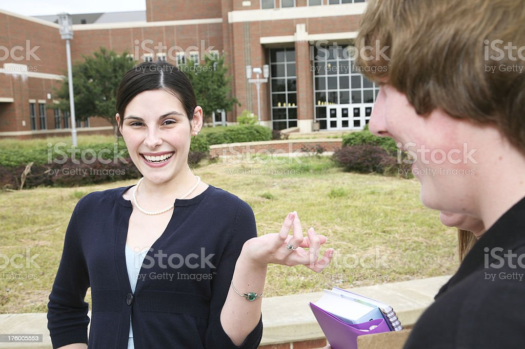 Happy Teacher Explaining Something to Her Students royalty-free stock photo