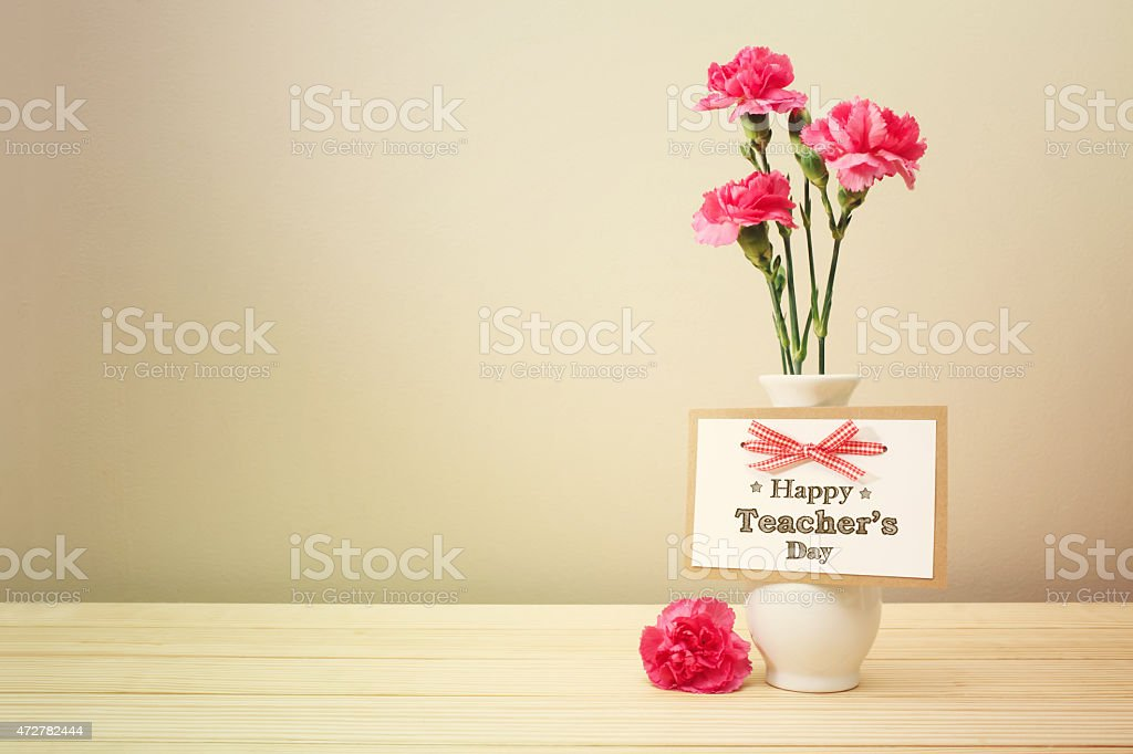 Happy Teachers Day message with carnations stock photo
