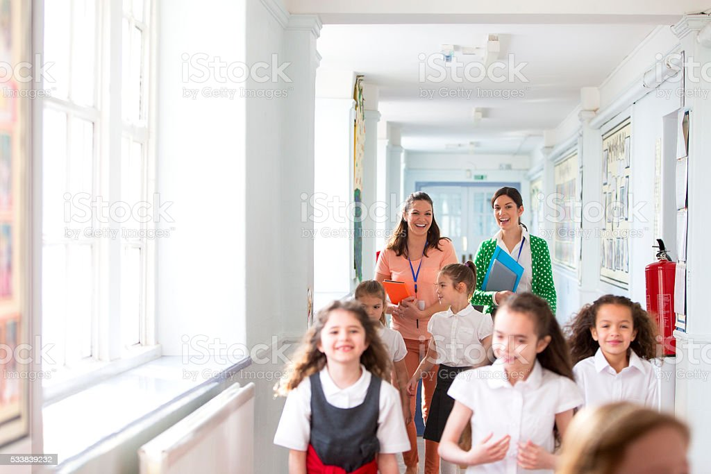 Happy Teachers Walking to Class stock photo