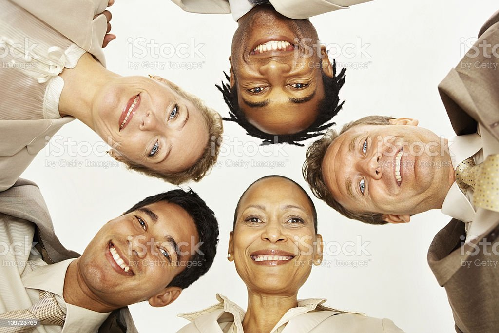 Happy team of business colleagues with their heads together royalty-free stock photo