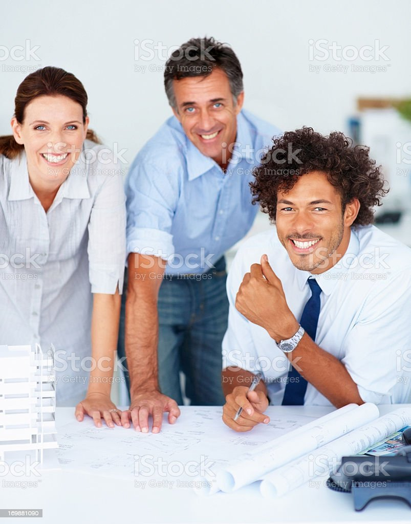 Happy team of newspaper journalist working together stock photo