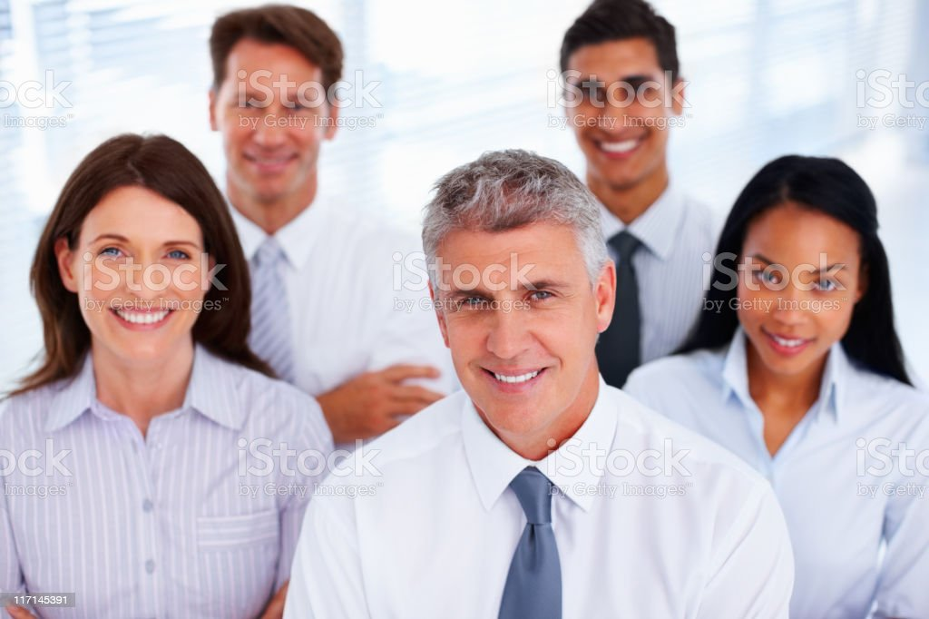 Happy team with their leader royalty-free stock photo