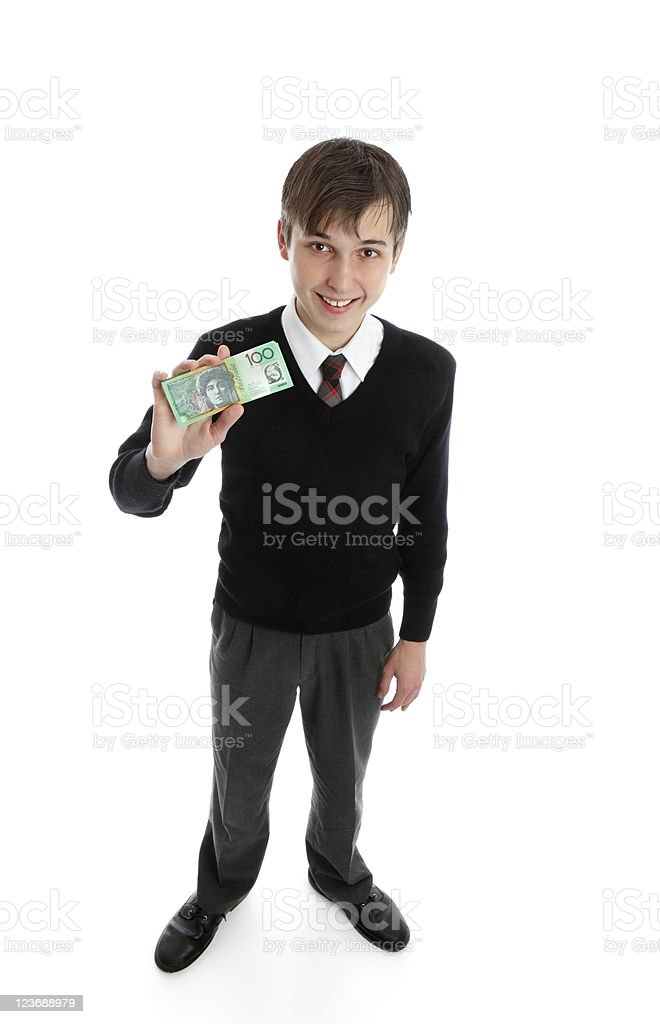 Happy teen boy holding money royalty-free stock photo