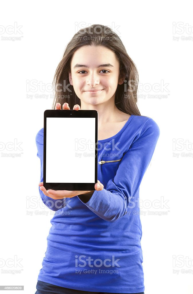Happy teen girl shows digital tablet royalty-free stock photo