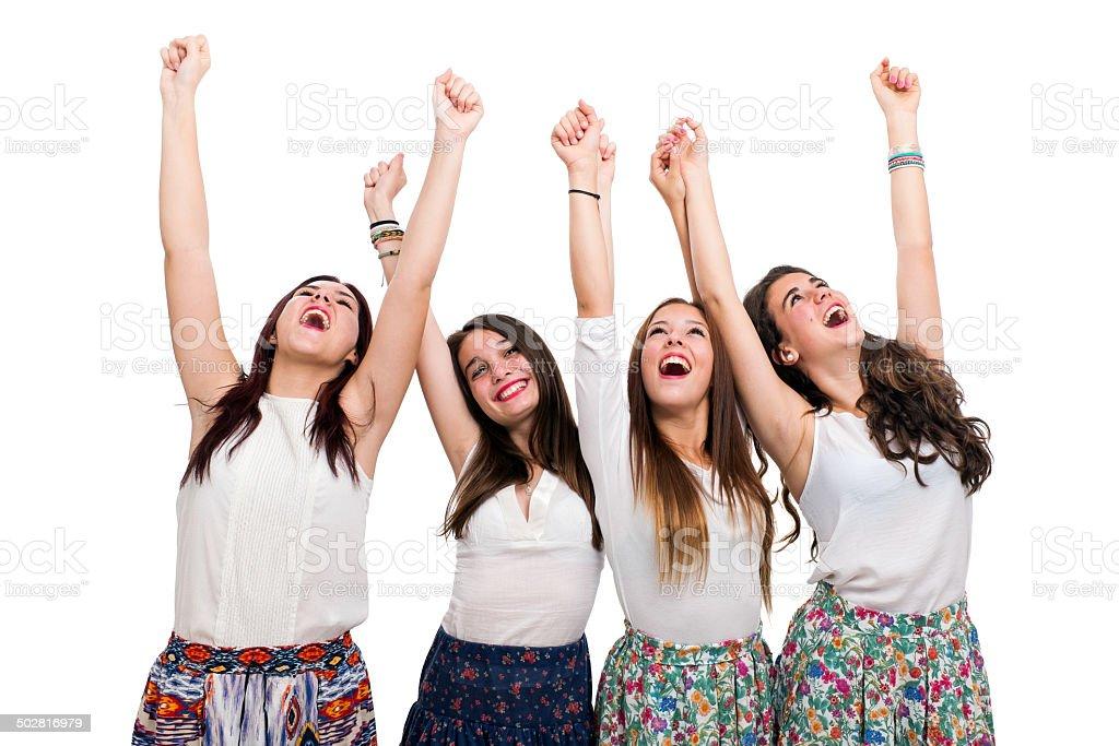 Heureux adolescentes lever les bras photo libre de droits
