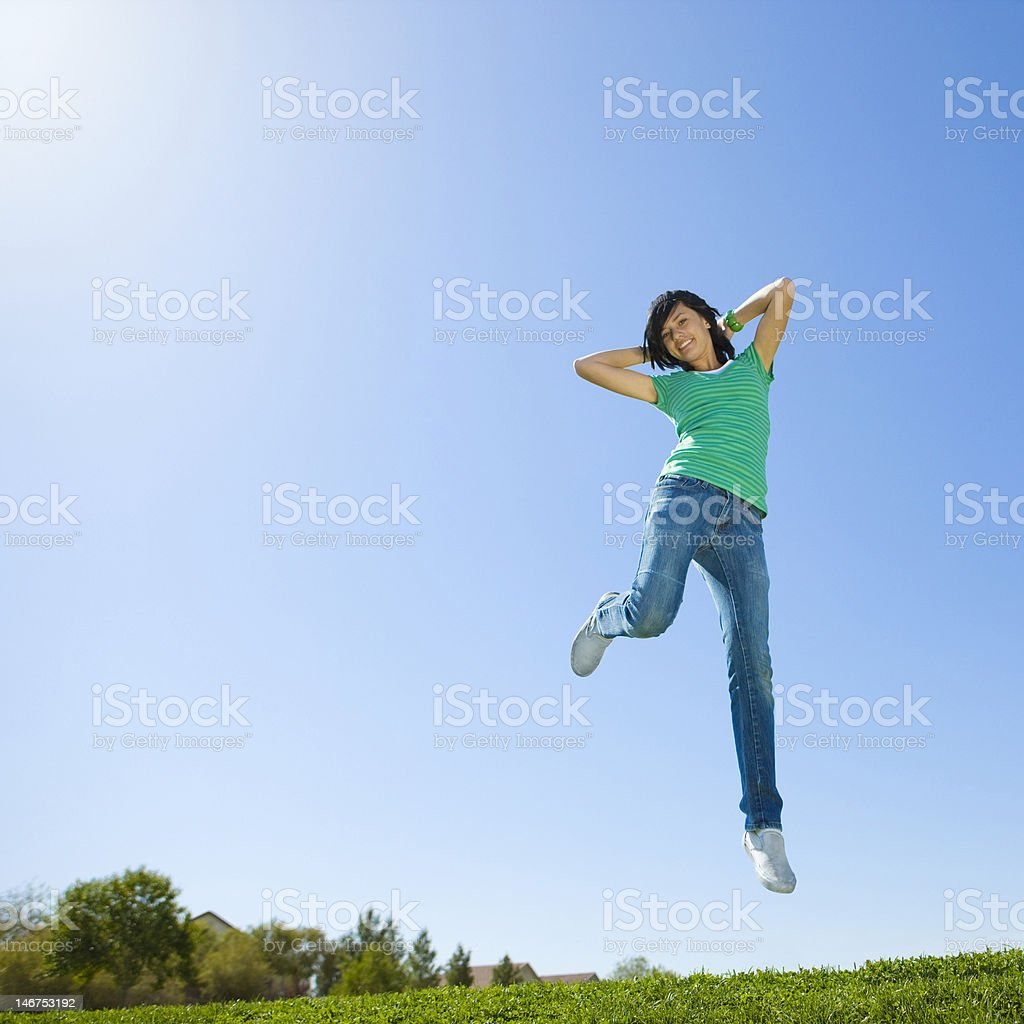 Happy teen jumps in air royalty-free stock photo