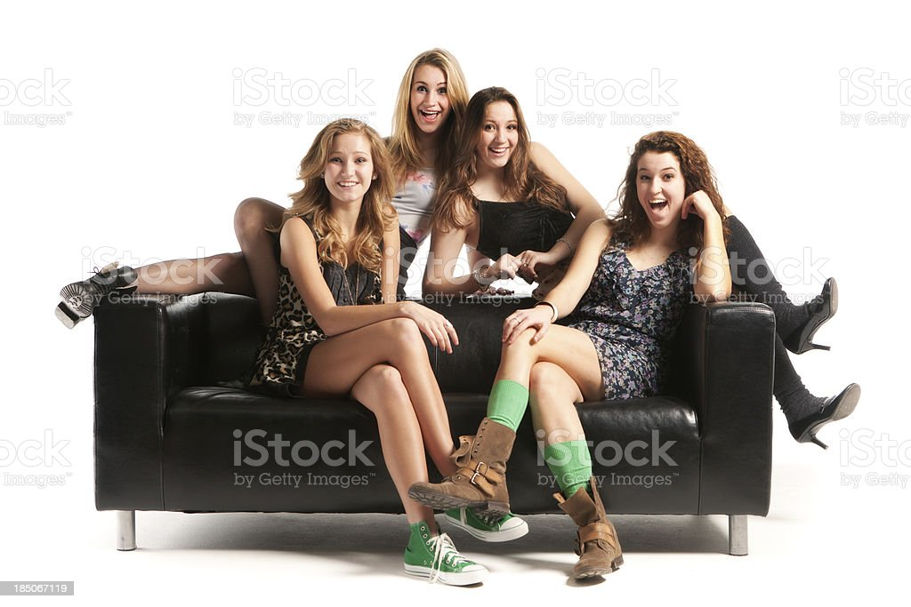 Happy Teen Models with Black Sofa on White Background Hz royalty-free stock photo