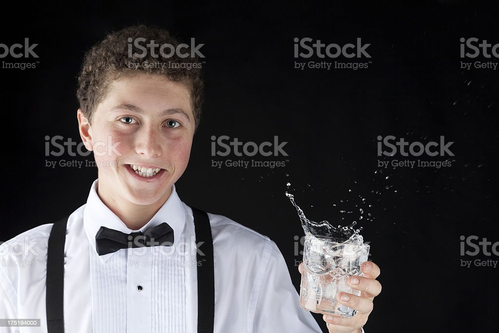 Happy Teen With A Splashing Drink royalty-free stock photo