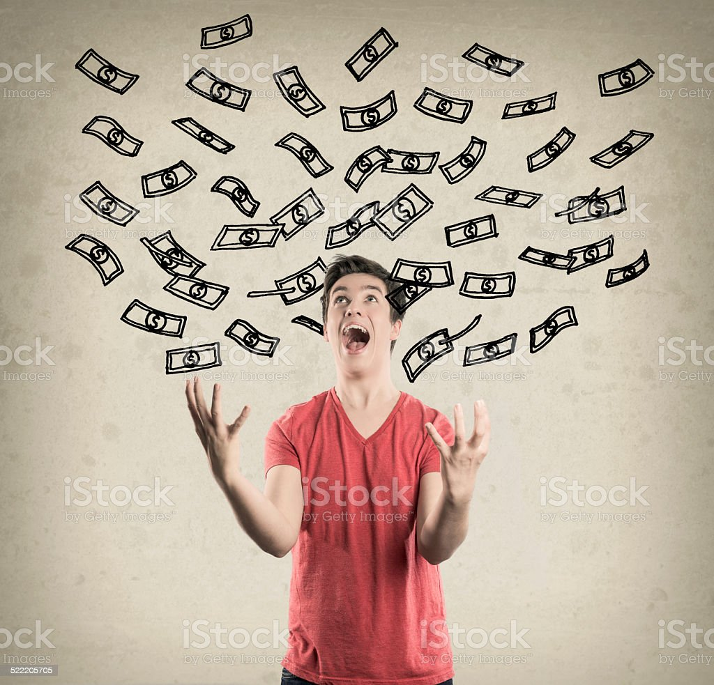 Happy Teenage Boy, showered in Dollar Bills stock photo