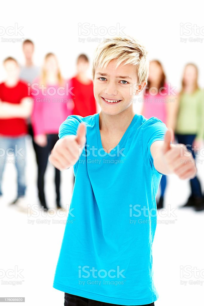 Happy teenage boy showing success sign royalty-free stock photo