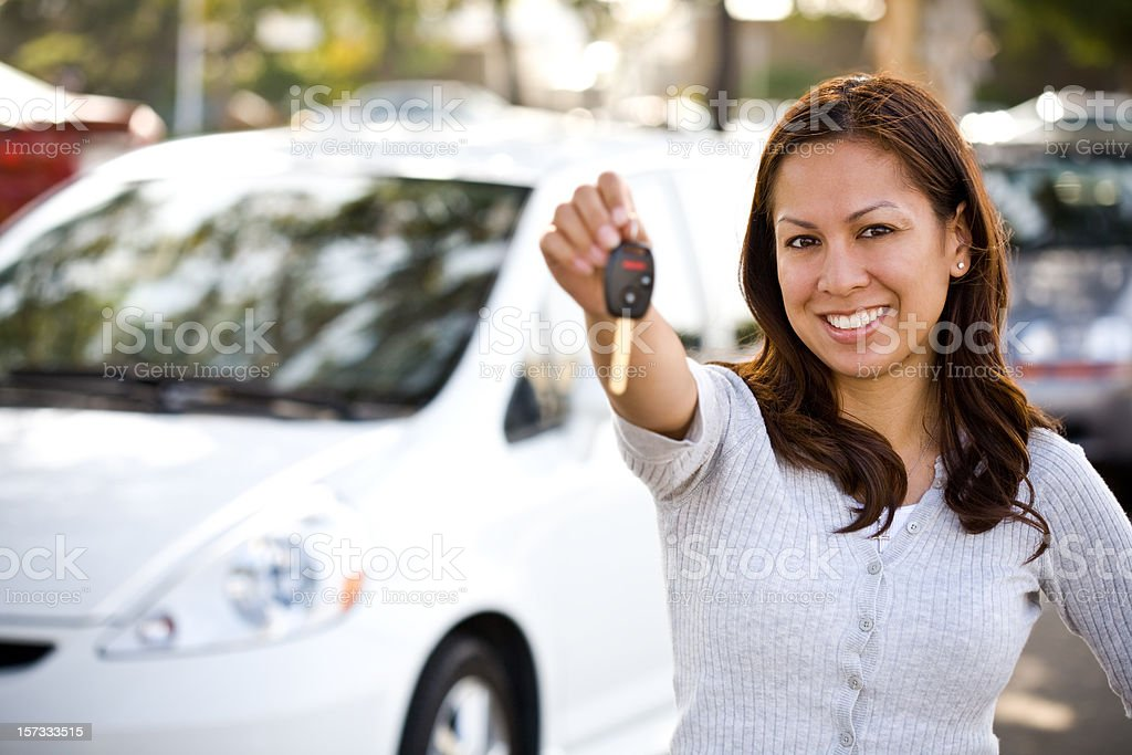 happy teenage driver holding keys stock photo