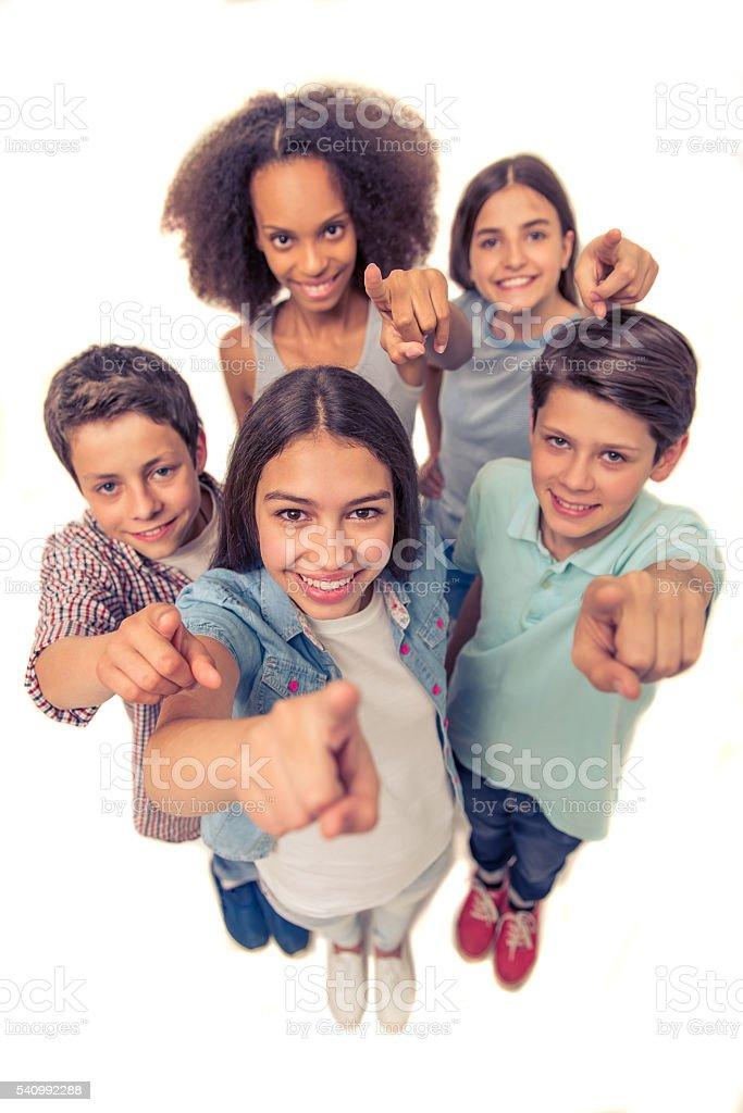 Happy teenage friends stock photo