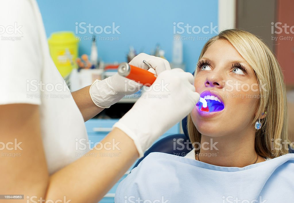 Happy Teenage Girl at dentist office royalty-free stock photo