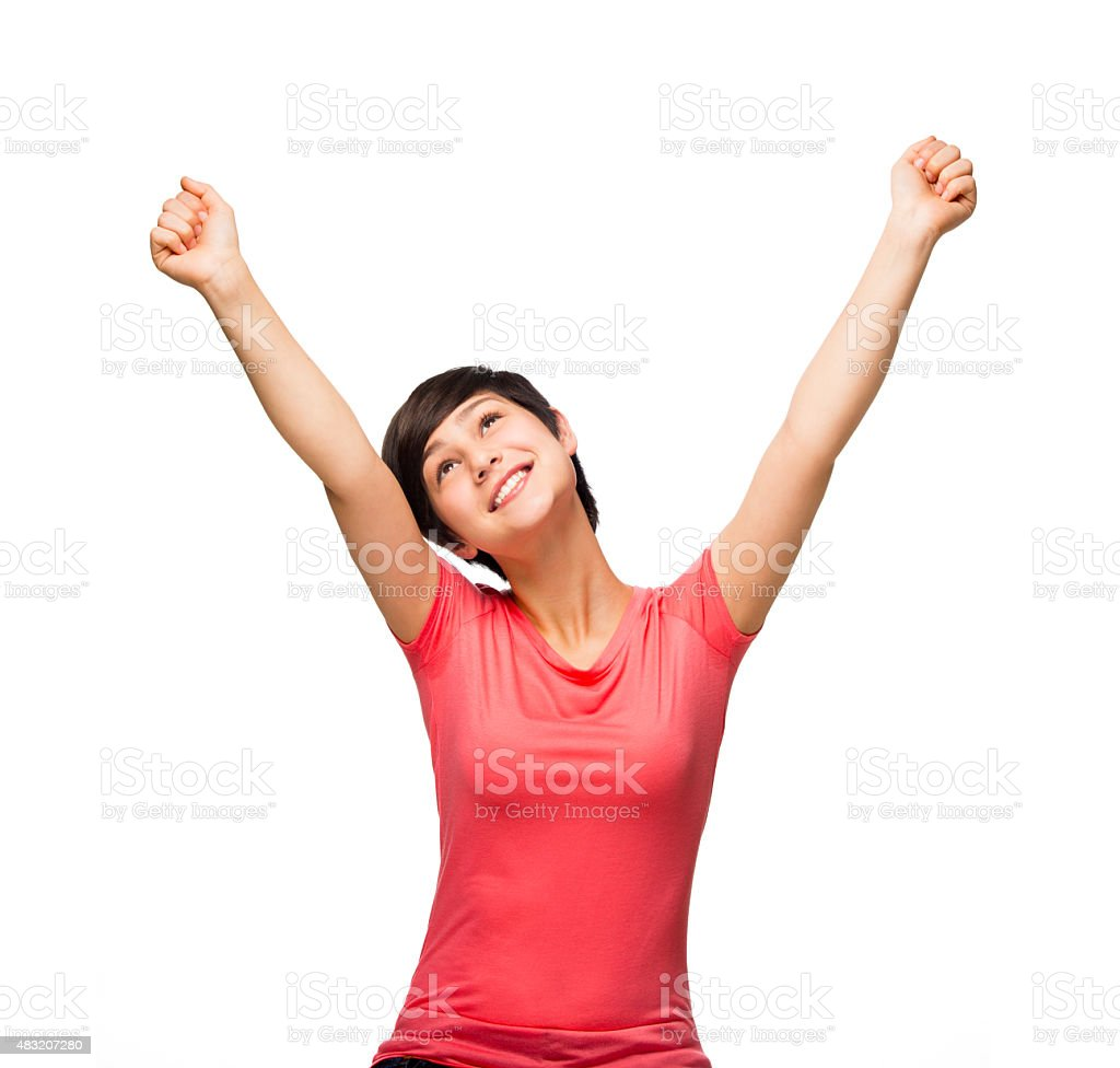 Happy teenage girl celebrating her success stock photo